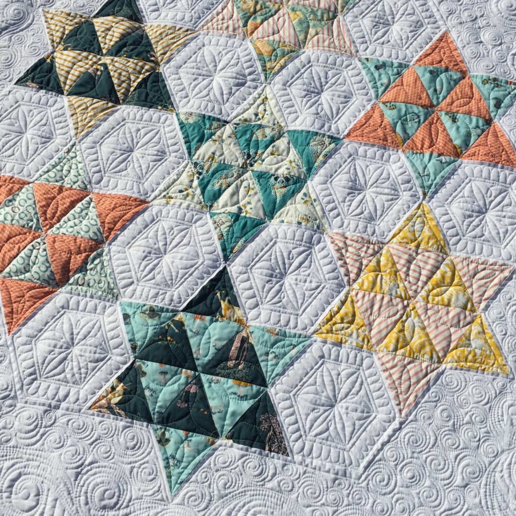 Jemmas triangle star quilt with fancy custom quilting
