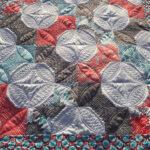Spool quilt with custom orange peel quilting